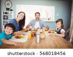 portrait of smiling family with ... | Shutterstock . vector #568018456