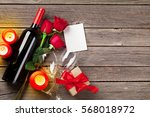Stock photo valentines day greeting card red rose flowers wine and gift box on wooden table top view with 568018972