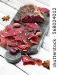 sliced homemade smoked beef on... | Shutterstock . vector #568024012