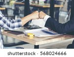 team business partners giving... | Shutterstock . vector #568024666