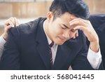 upset failure businessman.... | Shutterstock . vector #568041445