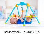 cute baby boy on colorful... | Shutterstock . vector #568049116