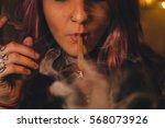 Small photo of Beautiful Woman Smoking a Blunt