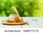 sweet honeycomb and wooden dish ... | Shutterstock . vector #568077172