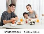 Happy Family Eating Breakfast...