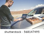 man at his stopped car resting  ... | Shutterstock . vector #568147495