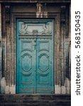 weathered  wooden door in an...