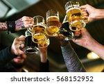 hands hold beverage beers...   Shutterstock . vector #568152952