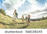 group of friends running on... | Shutterstock . vector #568158145