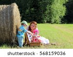 mother with twins in field | Shutterstock . vector #568159036