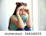 sad teenage girl sitting near... | Shutterstock . vector #568168525