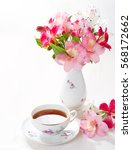 Small photo of Still life with cup of tea and flowers (Alstroemeria).