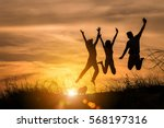 the silhouette of three people... | Shutterstock . vector #568197316