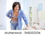beautiful young woman suffering ... | Shutterstock . vector #568202536