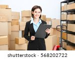 young woman with clipboard in... | Shutterstock . vector #568202722
