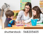 teacher working with children... | Shutterstock . vector #568205605