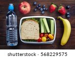 healthy lunch box with sandwich ... | Shutterstock . vector #568229575
