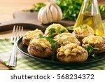 baked mushroom caps stuffed... | Shutterstock . vector #568234372