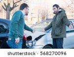 Two Men Arguing After A Car...