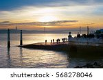 people watching sunset on... | Shutterstock . vector #568278046