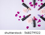 lipstick make up and flowers... | Shutterstock . vector #568279522