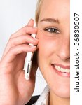 A close up of a young businesswoman talking on a mobile phone - stock photo