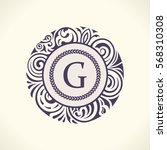 round calligraphic royal gold... | Shutterstock .eps vector #568310308
