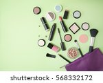 a purple make up bag with... | Shutterstock . vector #568332172