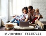 young happy family relaxing at... | Shutterstock . vector #568357186
