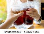 men and woman hand giving glass ... | Shutterstock . vector #568394158