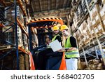 Warehouse logistics work being done with forklift - stock photo
