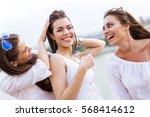 cheerful women having fun... | Shutterstock . vector #568414612