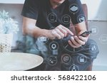 designer man hand using smart... | Shutterstock . vector #568422106