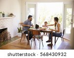 family enjoying meal at home... | Shutterstock . vector #568430932