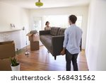 couple carrying sofa into new... | Shutterstock . vector #568431562