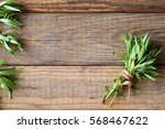 bunch of fresh tarragon on a... | Shutterstock . vector #568467622