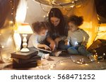 reading and family games in... | Shutterstock . vector #568471252