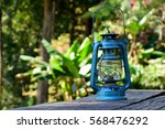 Hurricane Lamp On Table In The...