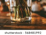 wedding rings near a vase with... | Shutterstock . vector #568481992