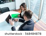 business couple working... | Shutterstock . vector #568484878