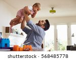 father sits at table and plays... | Shutterstock . vector #568485778