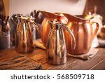 copper jars on the wooden table   Shutterstock . vector #568509718