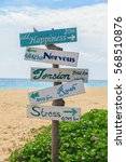 Stock photo emotion wooden sign on beach at tachai island soulth of thailand 568510876