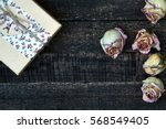 white pink dried roses and gift ...   Shutterstock . vector #568549405
