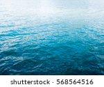 blue ripple water wave on sand... | Shutterstock . vector #568564516