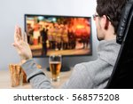 agitated man watching  on tv ... | Shutterstock . vector #568575208