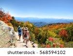 people with backpacks hiking on ... | Shutterstock . vector #568594102