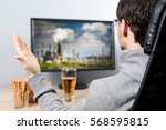 agitated man watching  on tv ... | Shutterstock . vector #568595815