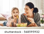happy loving family. mother and ... | Shutterstock . vector #568595932