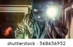 masked burglar with torch and... | Shutterstock . vector #568656952